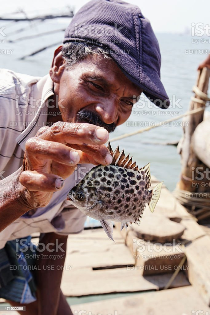 Man  showing a fish stock photo