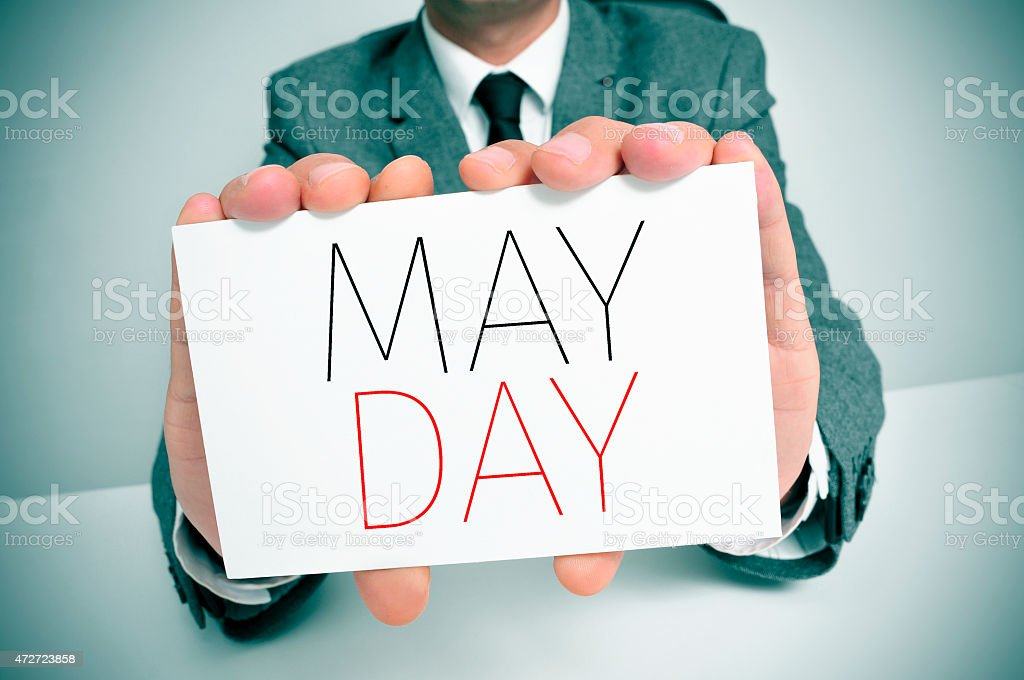 man showing a signboard with the text may day stock photo
