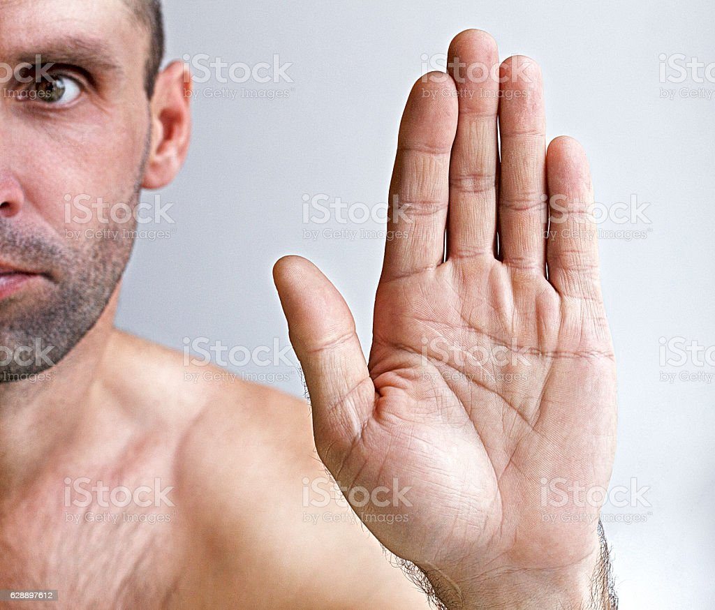 Man showing a stop stock photo
