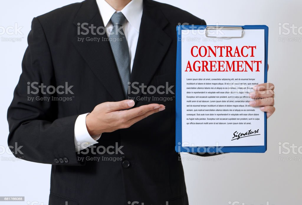 man showing a written contract agreement stock photo