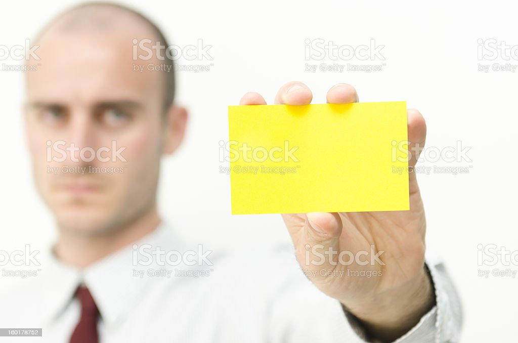 Man showing a yellow Business Card royalty-free stock photo