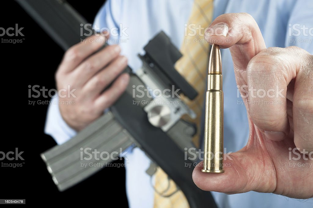 Man showing bullet royalty-free stock photo
