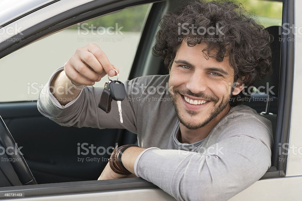 Man Showing Car Key stock photo
