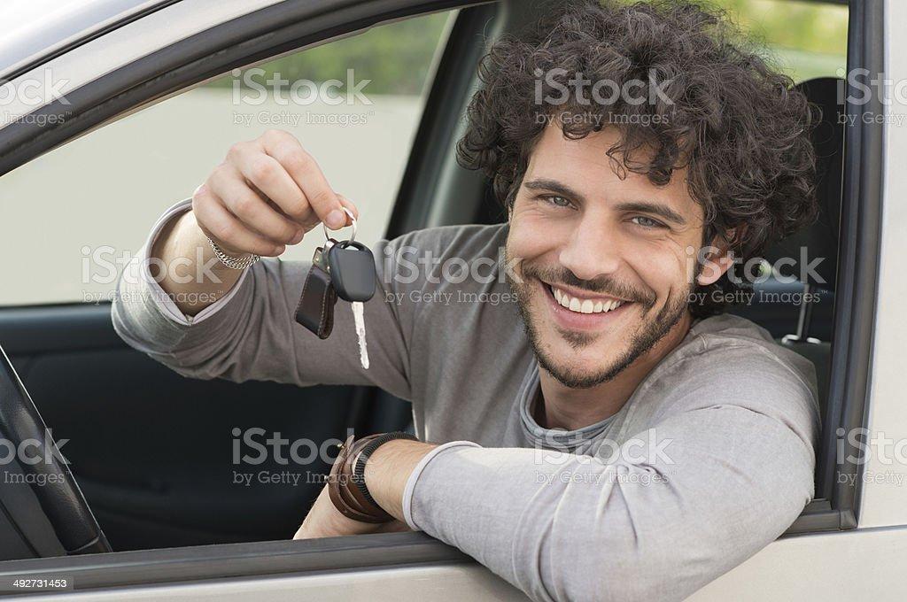 Man Showing Car Key stock photo