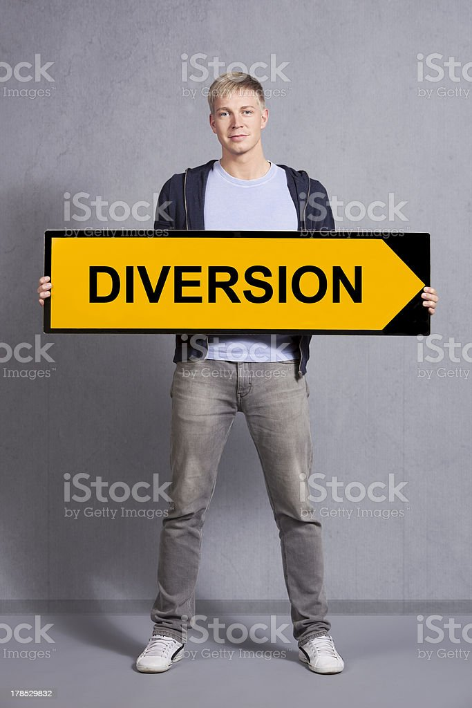 Man showing diversion sign. royalty-free stock photo