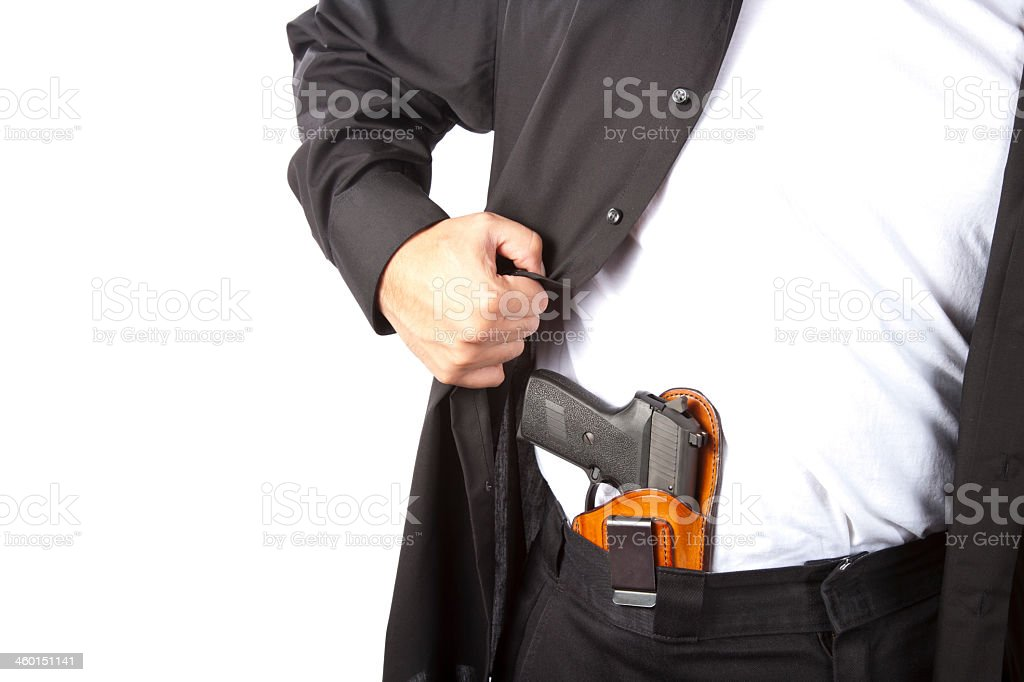 A man showing his concealed gun stock photo
