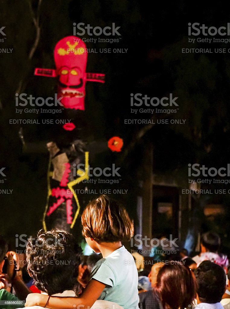 Man showing his daughter the dussera celebrations stock photo
