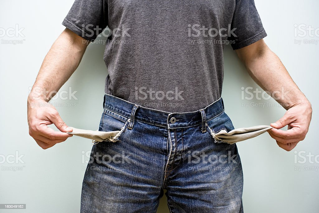 A man showing his empty pockets royalty-free stock photo