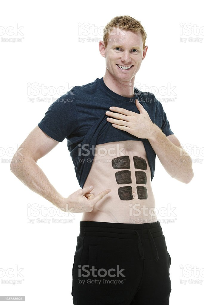Man showing his fake six pack muscles royalty-free stock photo