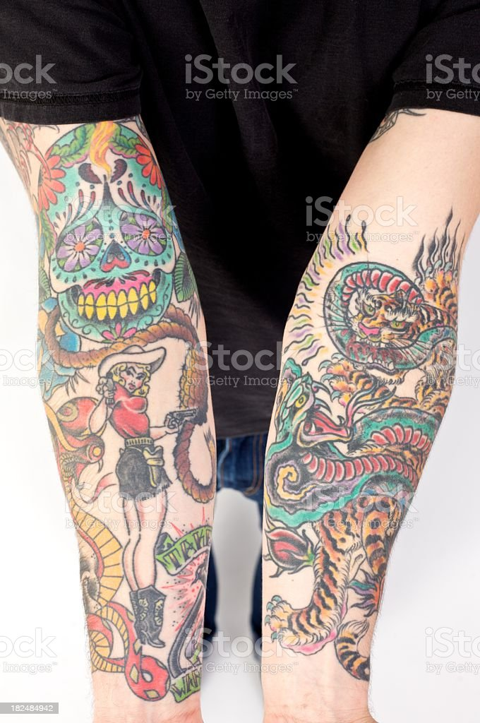 A man showing his tattooed arms stock photo