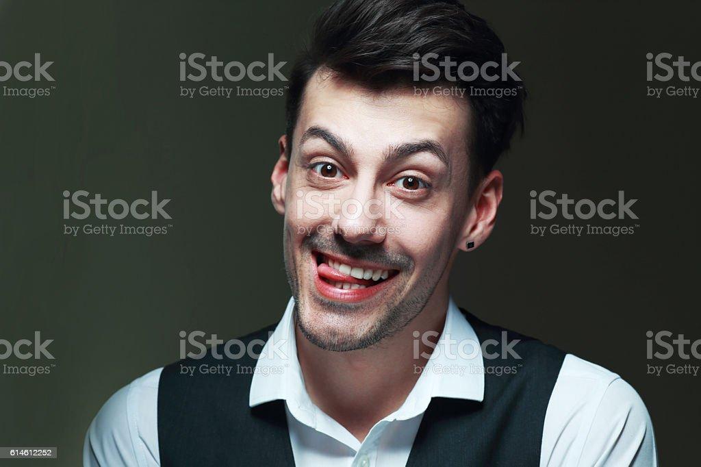 man showing his tongue stock photo