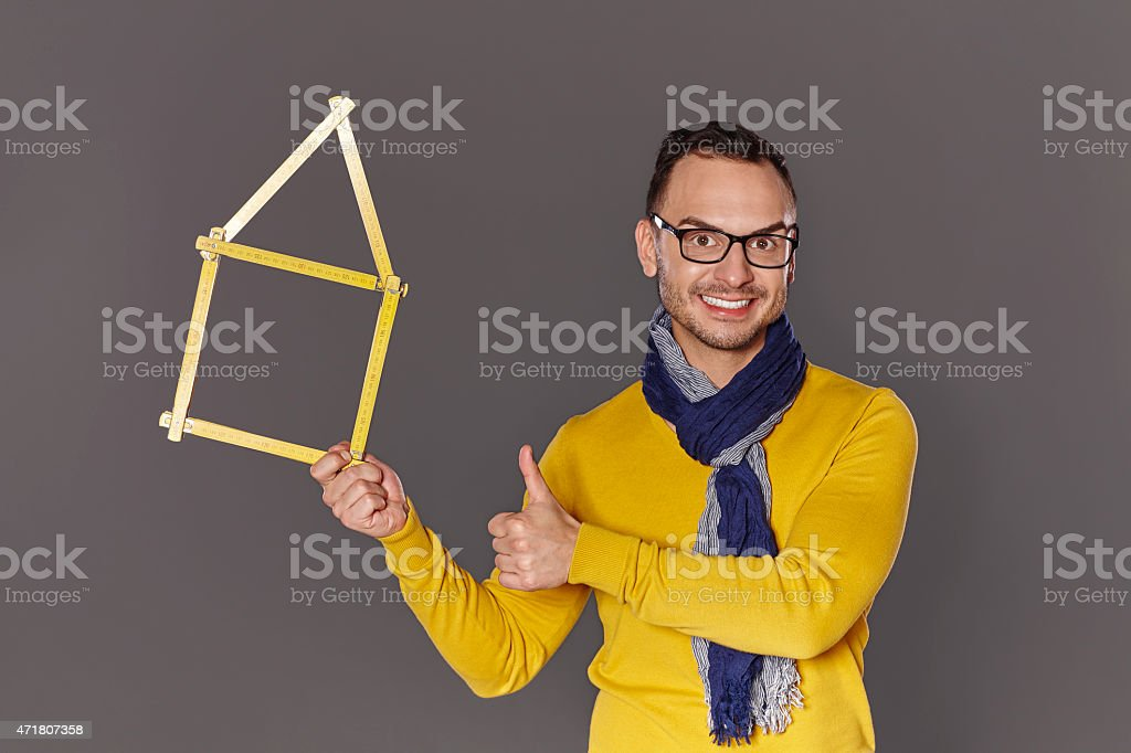Man showing house frame concept stock photo