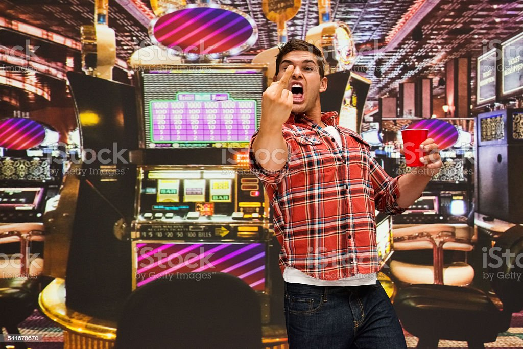 Man showing obscene gesture at casino stock photo
