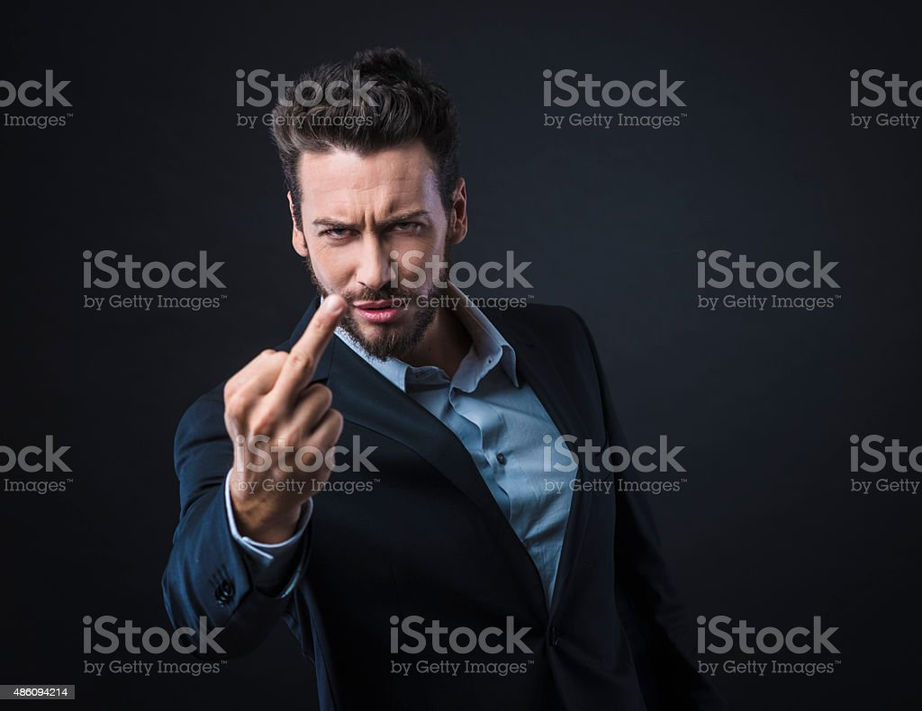 Man showing off middle finger stock photo