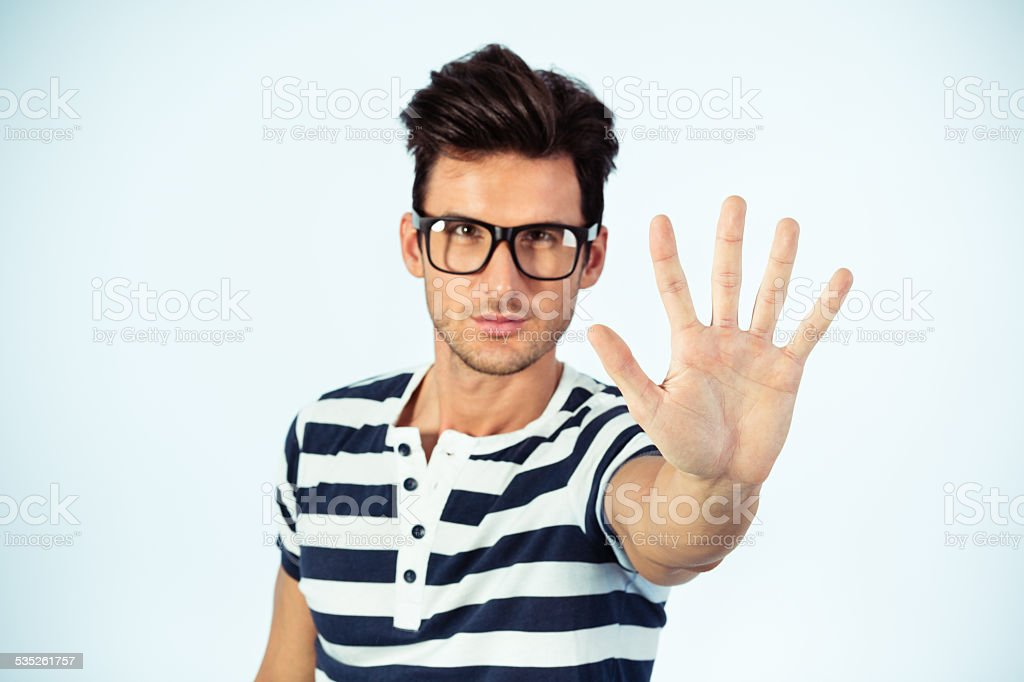 Man showing STOP sign with his hand stock photo