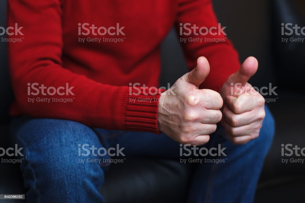 Man showing thumbs up. stock photo