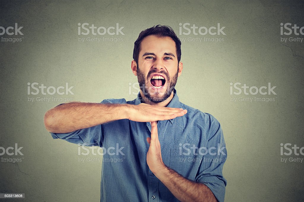man showing time out hand gesture frustrated screaming stop stock photo