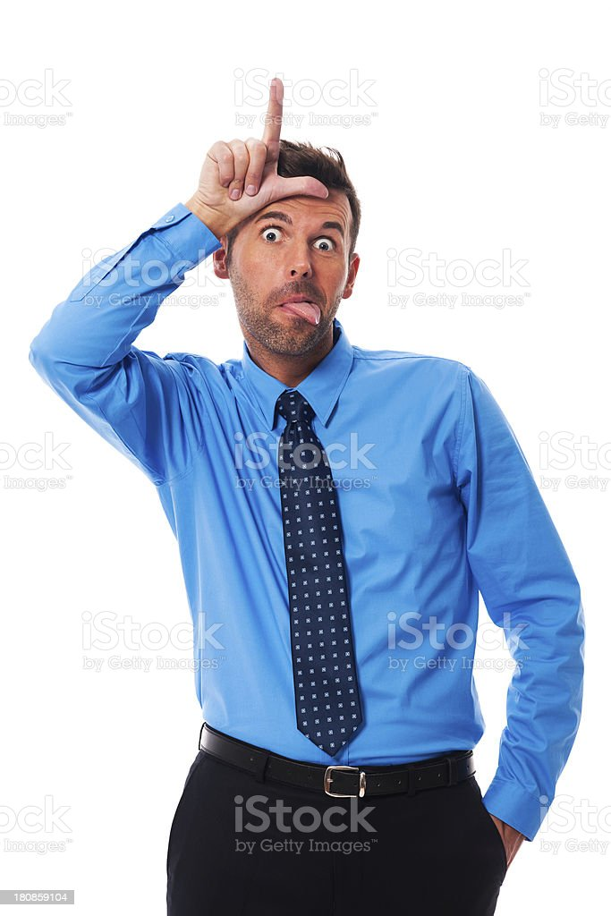 Man showing tongue and loser sign stock photo
