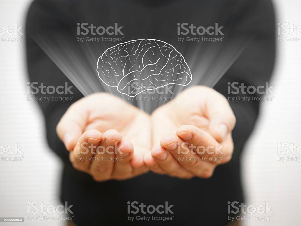 man showing virtual brains on open palm, idea concept stock photo