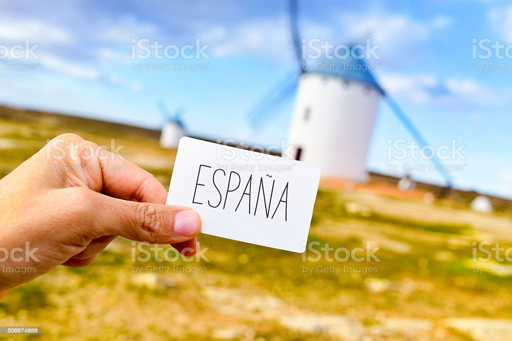 man shows a signboard with the word Espana stock photo