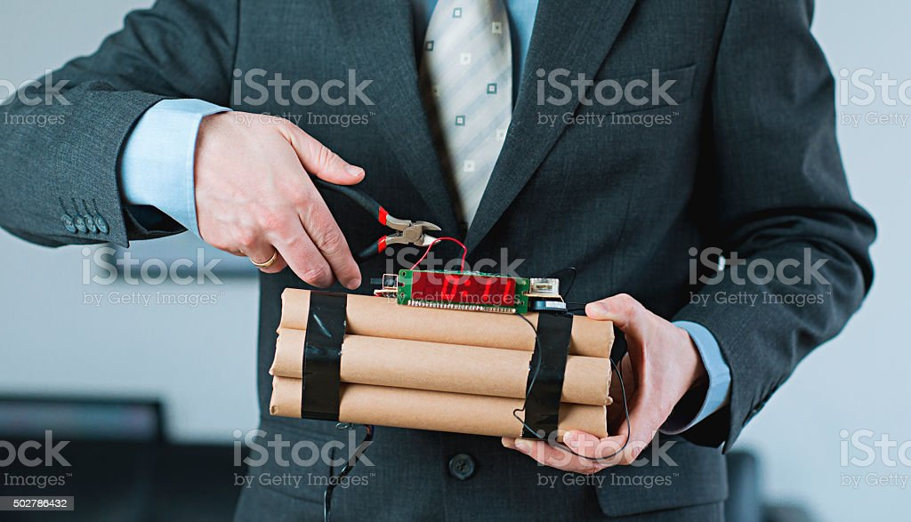 Man shows leadership and decision making while disarming bomb stock photo