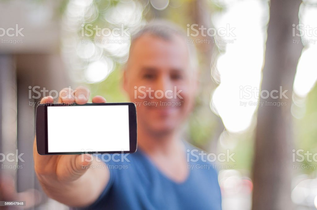 Man shows mobile smart phone. Blank screen. stock photo