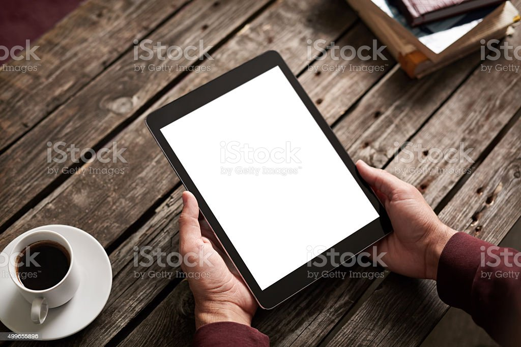 Man shows screen of tablet in his hands stock photo