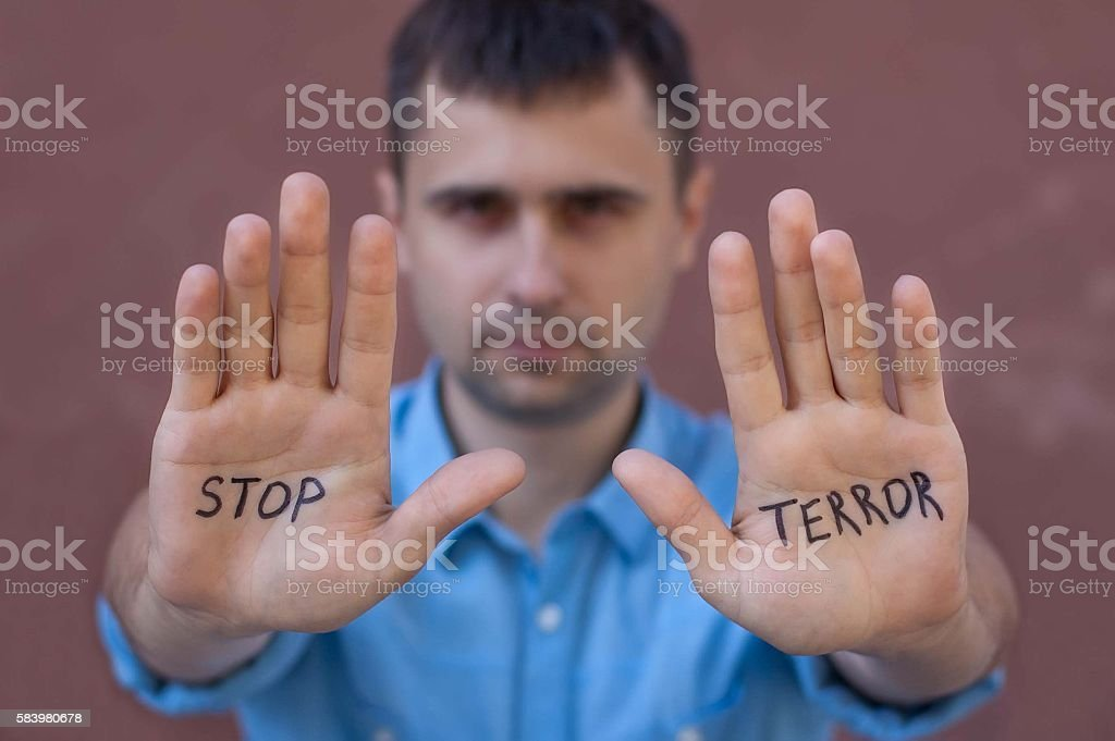 Man shows the palm gesture with an inscription Stop Terror stock photo