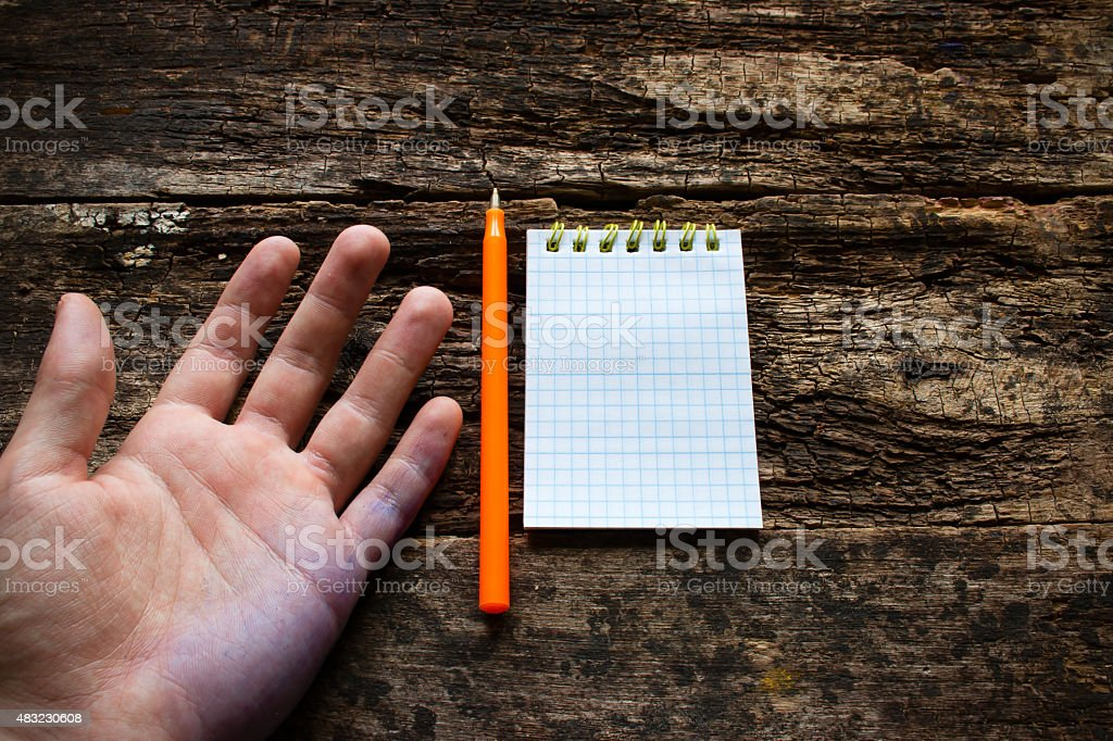 man shows the problem lefties International Lefthanders Day stock photo