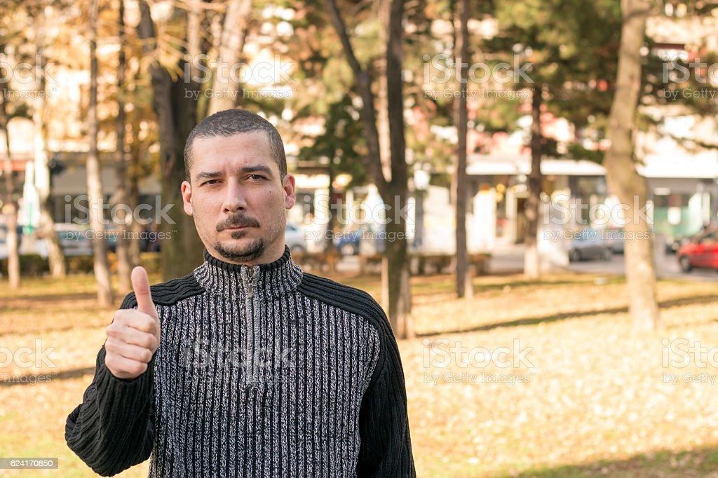Man shows  thumb up stock photo