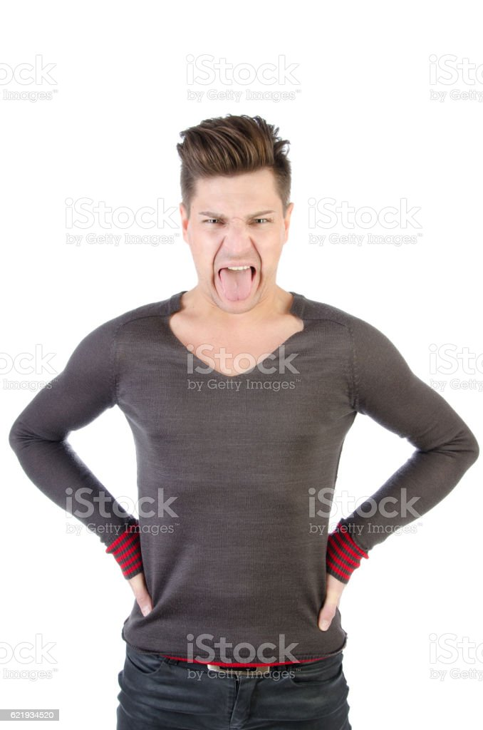Man shows tongue stock photo
