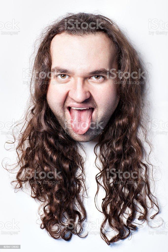 Man shows tongue. stock photo