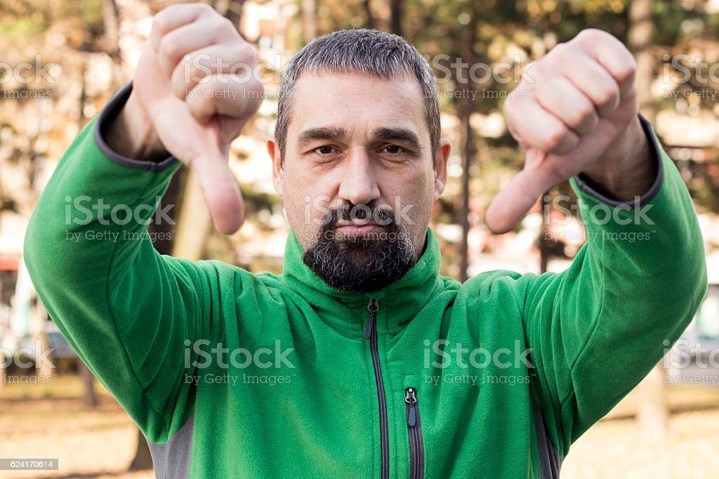 Man shows two thumbs down stock photo
