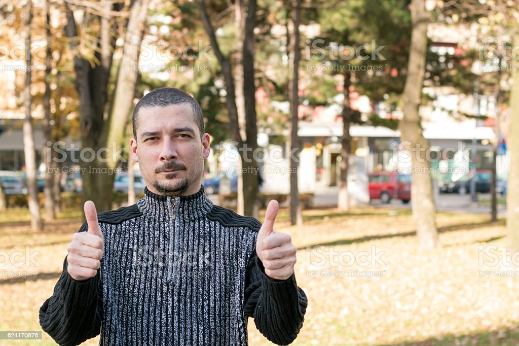 Man shows two thumbs up stock photo