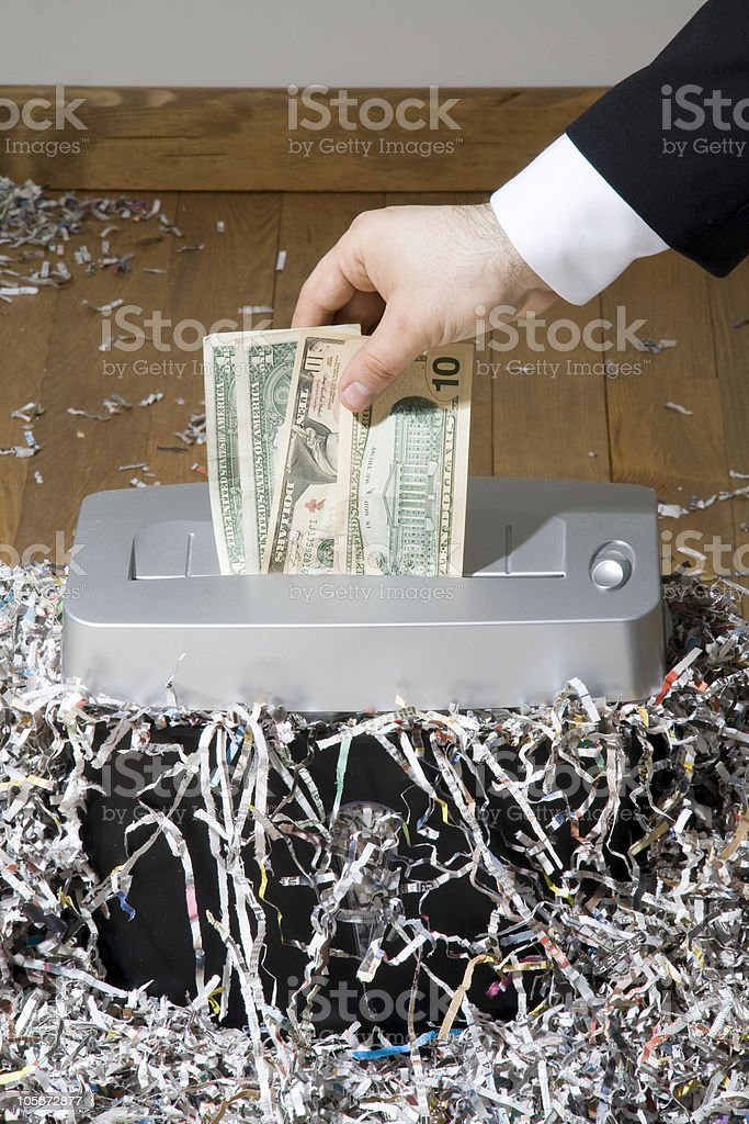 Man shredding one hundred dollar banknote stock photo