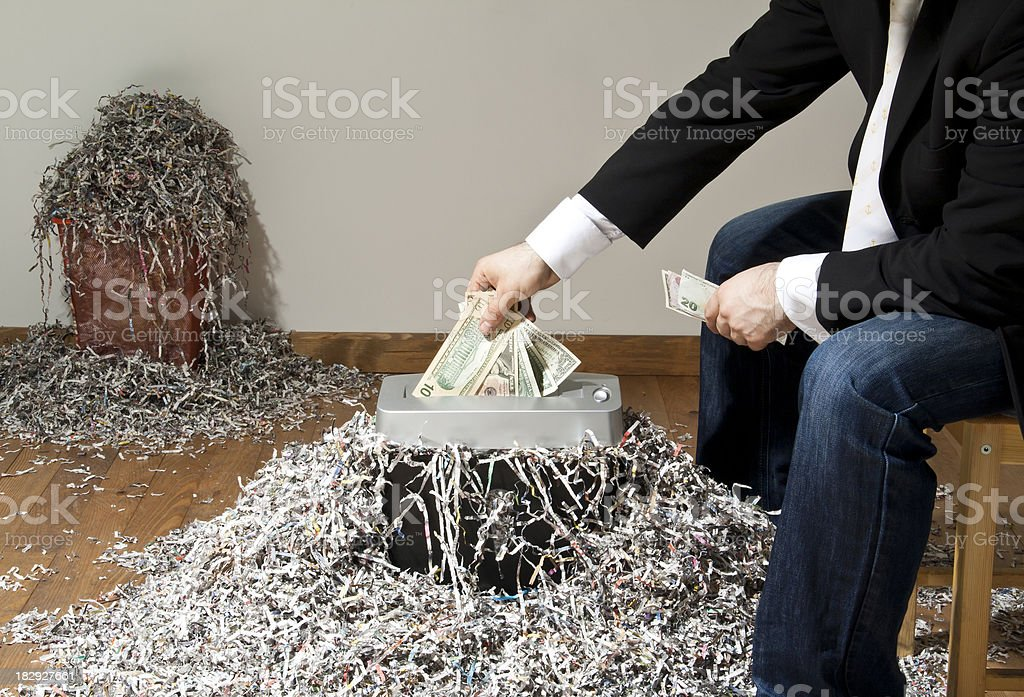 Man shredding one hundred dollar banknote royalty-free stock photo