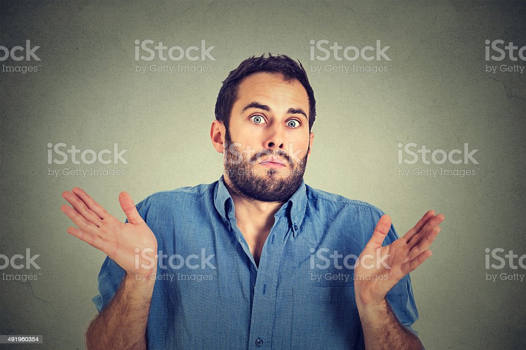 man shrugging shoulders who cares I don't know stock photo