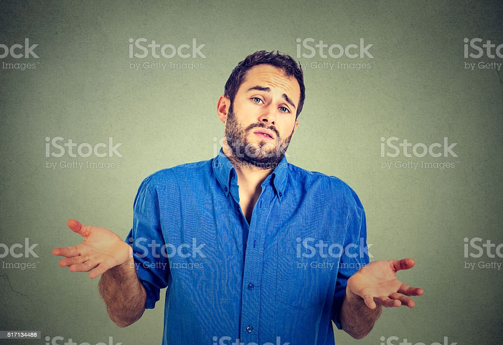man shrugging shoulders who cares so what stock photo
