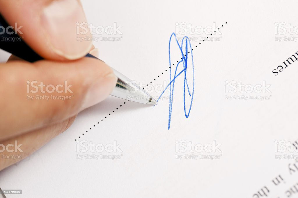 Man signing a contract stock photo