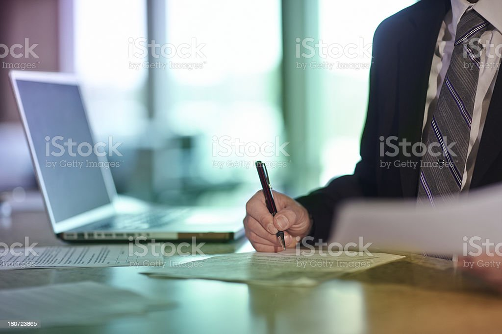 Man Signing Documents royalty-free stock photo