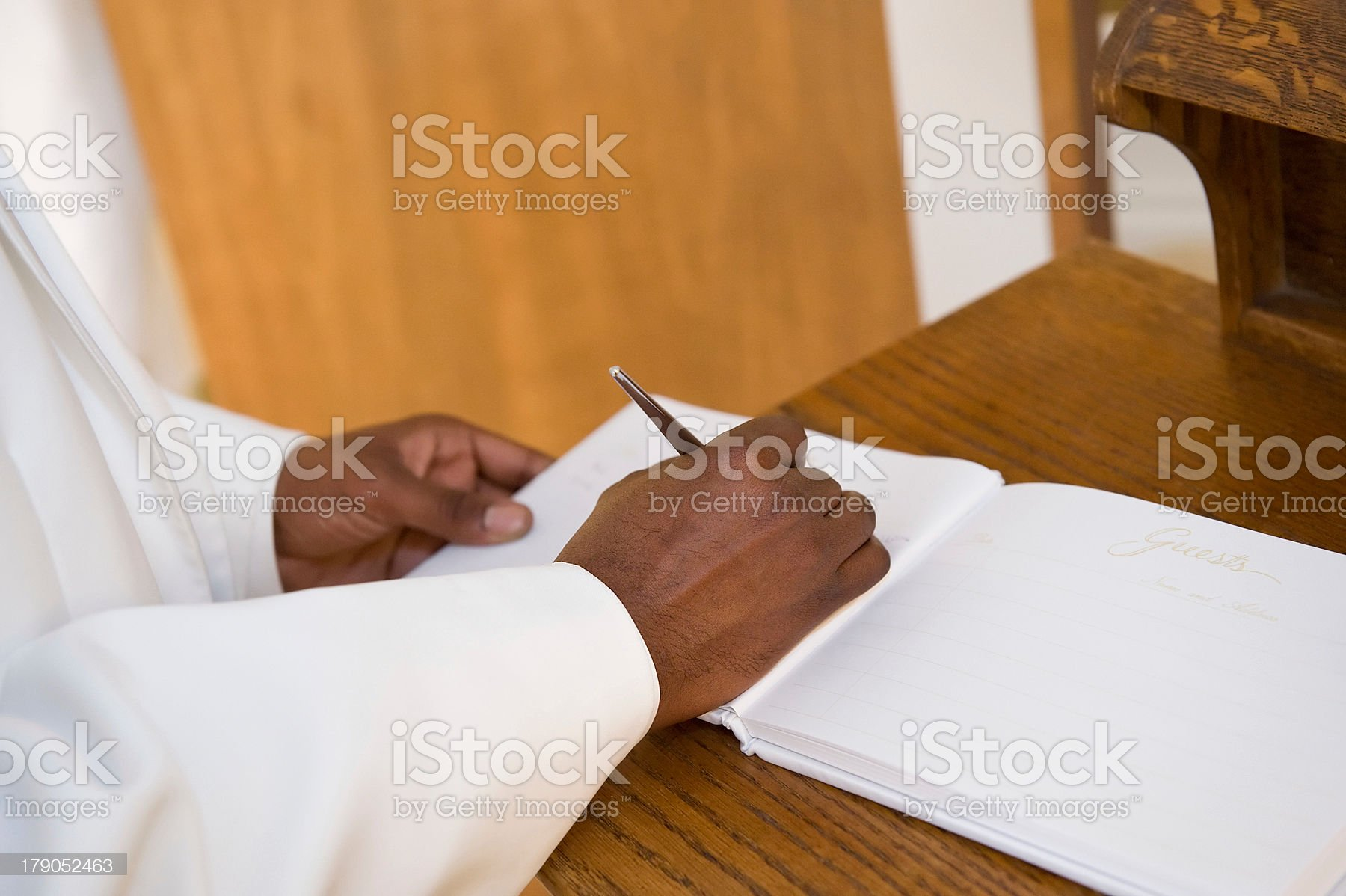 Man signing guest book royalty-free stock photo