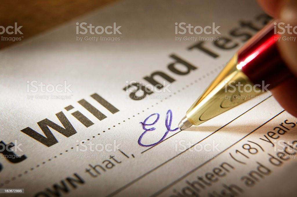 Man Signing Last Will & Testament stock photo