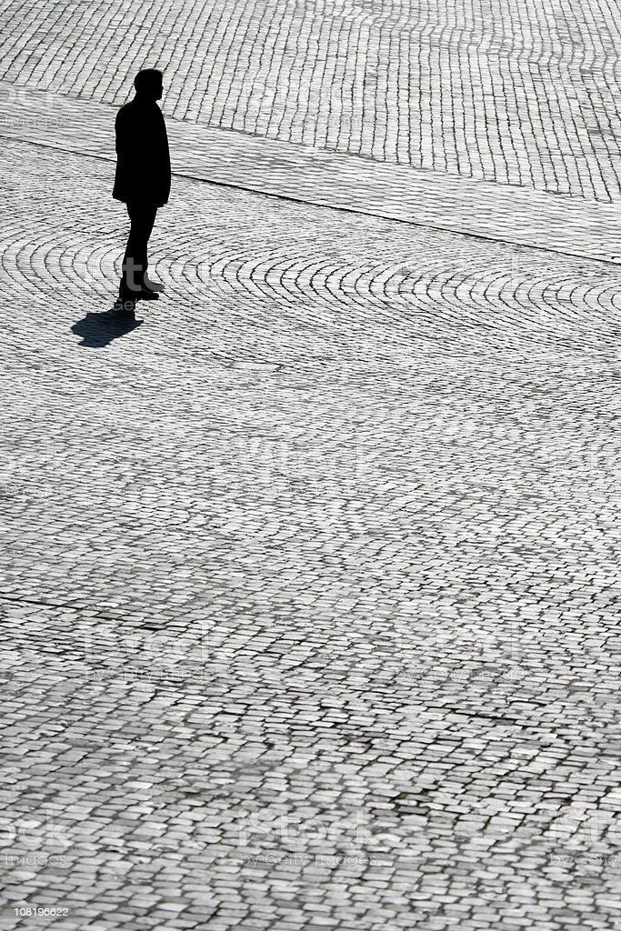 Man silhouette and cobblestone royalty-free stock photo
