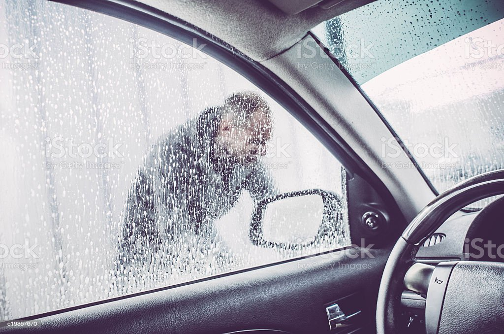 Man silhouette - car wash and soap bubble stock photo
