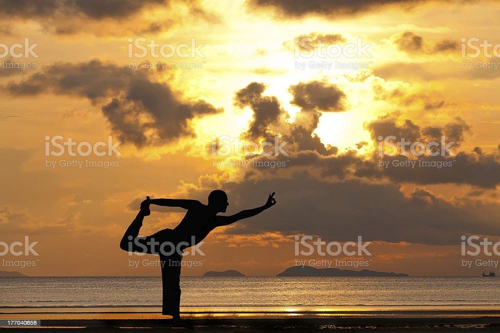 Man silhouette doing yoga exercise natarja royalty-free stock photo