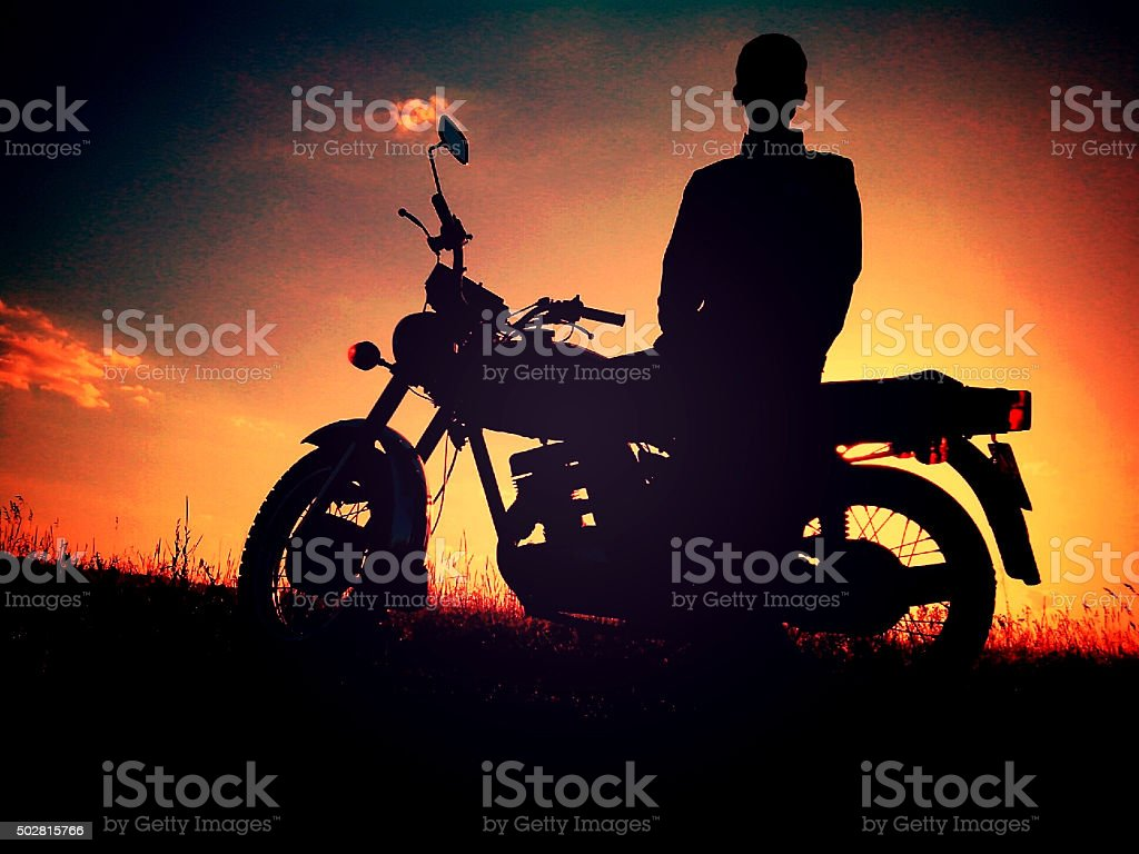Man silhouette on a motorcycle stock photo