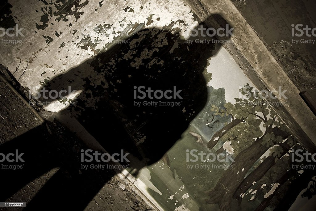 Man silhouette on grunge wall in abandoned camp royalty-free stock photo