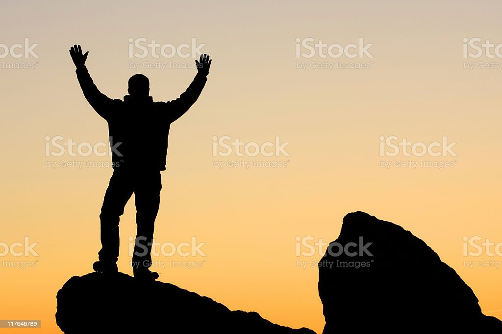 man silhouette on rocks royalty-free stock photo