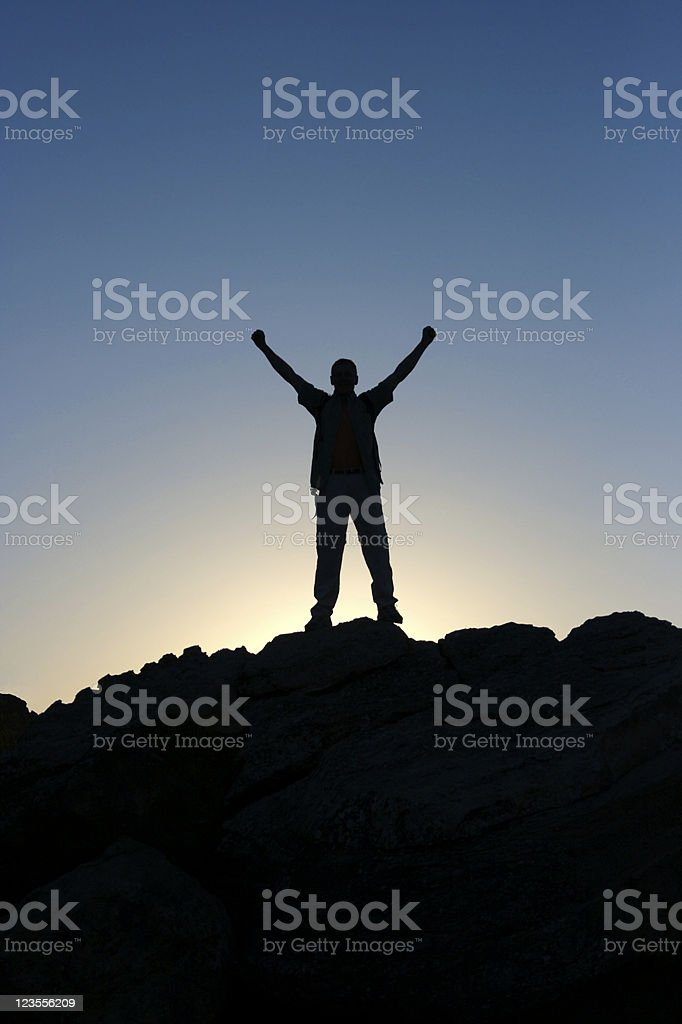 Man silhouette standing on top of mountain royalty-free stock photo