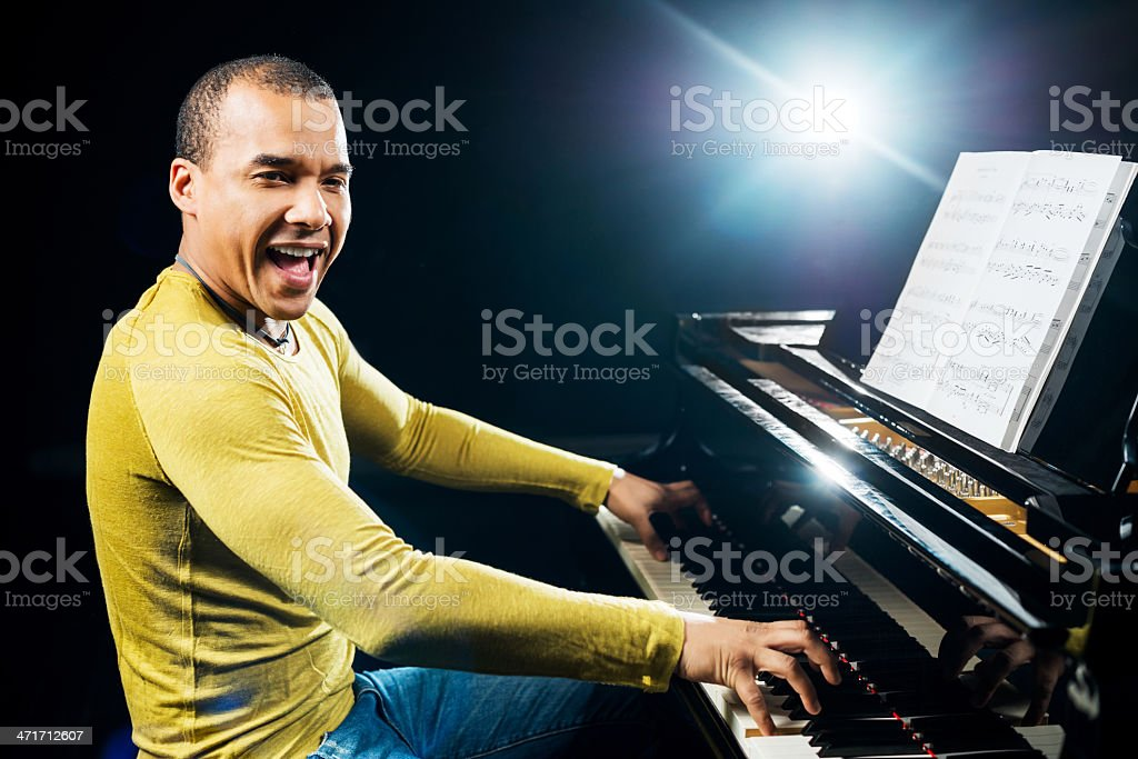 Man singing and playing the piano. royalty-free stock photo